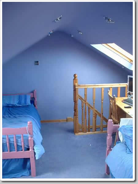 Photo of Simple converted bedroom loft conversion with velux roof windows